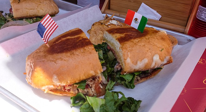 A La Forntera torta at El Carrito, with the Mexican flag planted on the carne asada half.