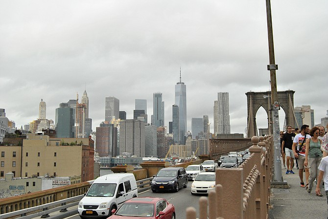 On the Brooklyn bridge looking out to the city of Manhattan.