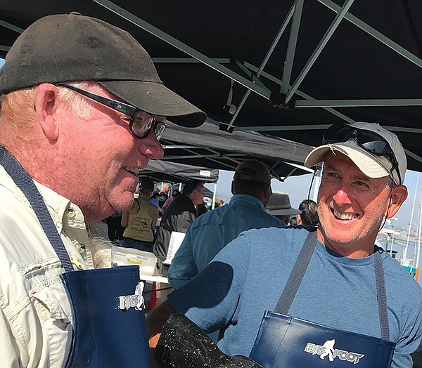 Randy Hupp, left, and fellow fisherman