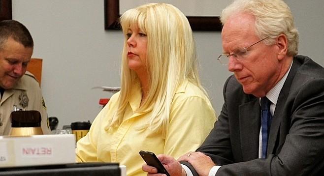 Julie between trials, at liberty on bond, w attorney Paul Pfingst. Photo by Eva Knott.