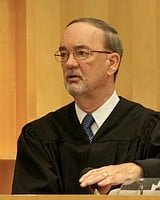 Hon. judge Kirkman signed the plea deal.