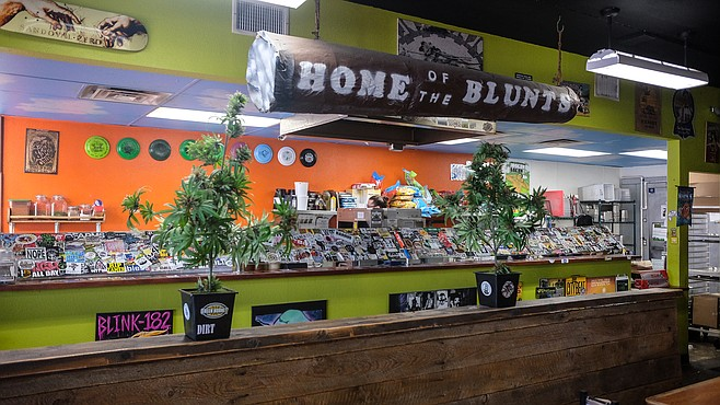 Cannabis references abound, including plastic plants.