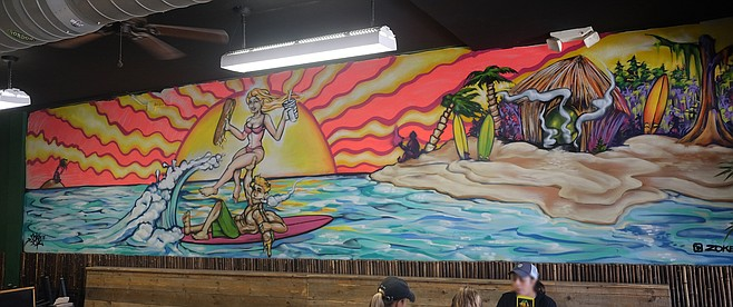 A smoking surfer mural at Cheba Hut