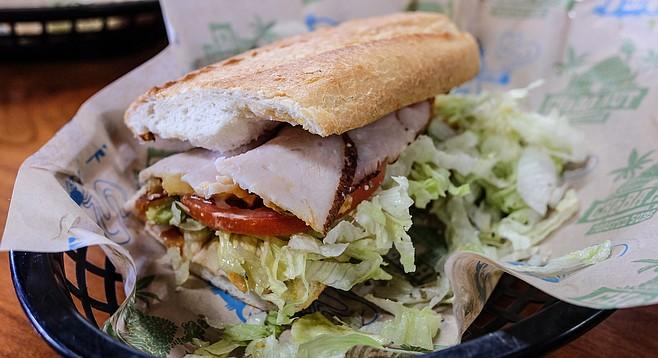 "Half of a 12-inch ""blunt"" of ""Kali Mist,"" a.k.a. California club sandwich at Cheba Hut."
