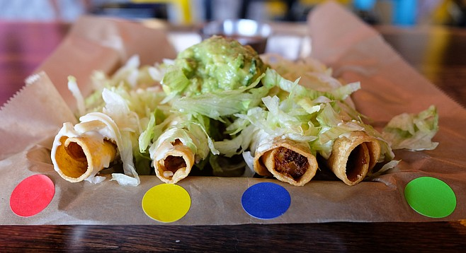 Color coded rolled tacos, from beef to vegan.