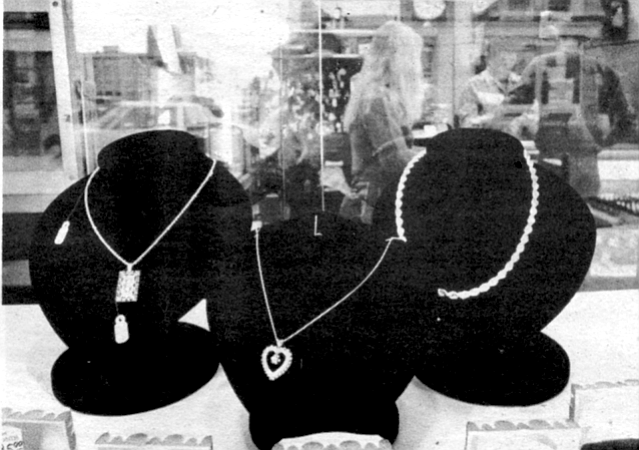 Smith and he begin a good-natured hassle over the price of a heavy gold necklace and pendant studded with diamonds.