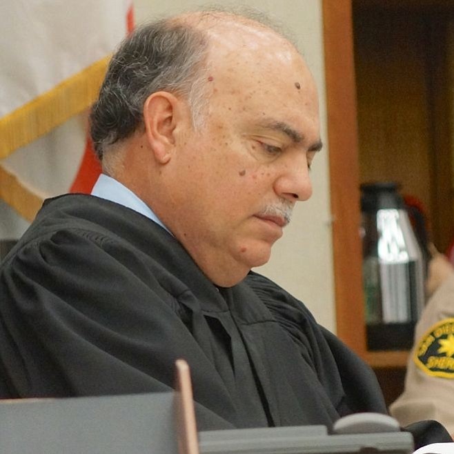 Hon. judge Carlos Armour.