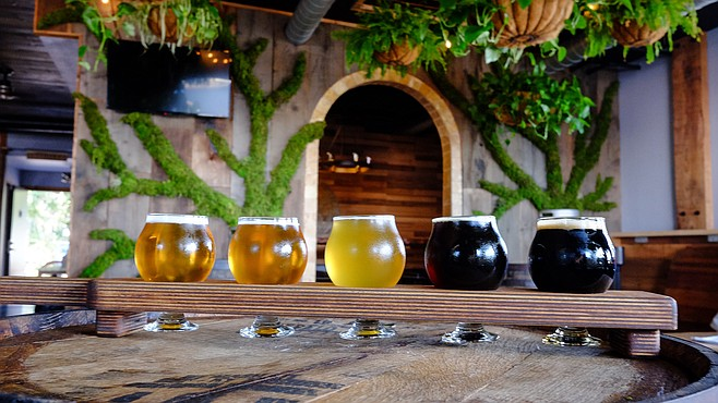 A flight of beers and plenty of greenery in Bear Roots' Vista Village taproom.