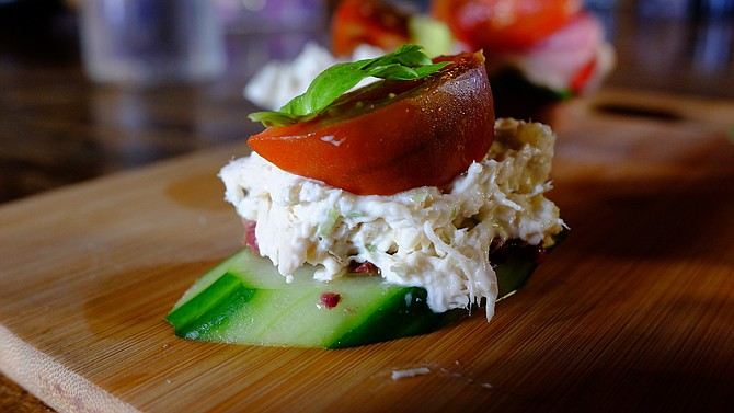 Tuna bites use cucumber slices as an alternative to a ciabatta roll.
