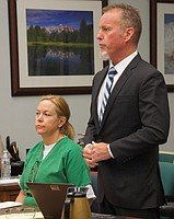Julie Harper w her new atty Brian Dooley in court this morning, Aug 22 2018. Photo by Eva Knott.