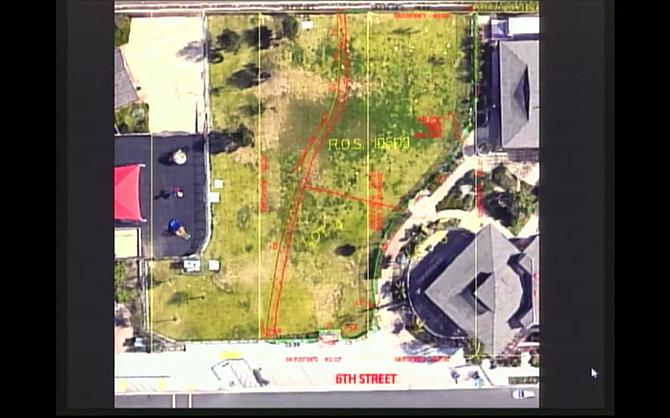 Proposed dog park between two school buildings