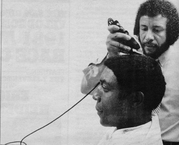 Willie Morrow cutting Willie McCovey. hair