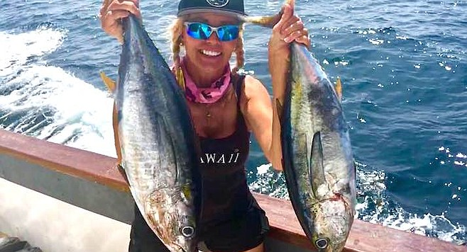 Katharina Eckert with a pair of football tunas caught aboard the Chief.