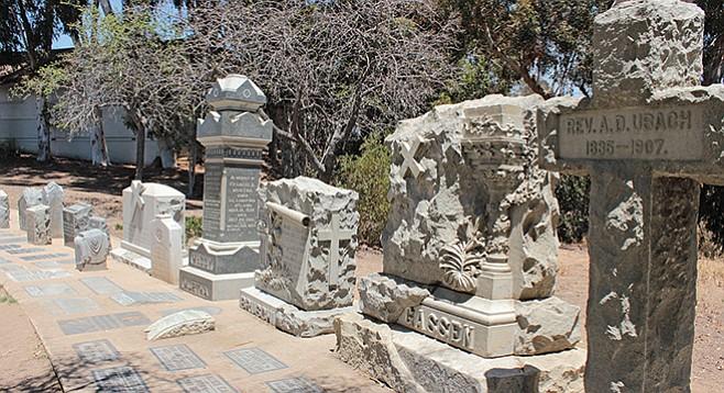 Bank of memorial tombstones in the southeast corner of the park