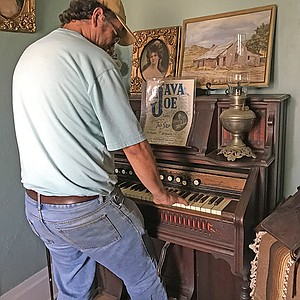 Christopher Pro, caretaker and historian, plays the Steins' foot-pumped organ