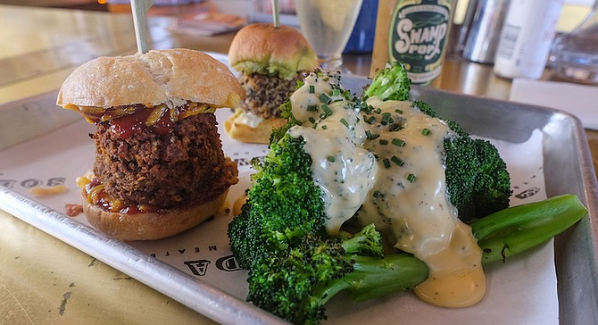 Left to right: seitan slider, quinoa slider, cheesy broccoli, and Swamp Pop