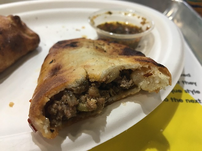 The beef empanada is filled with savory ground, onions and spices.