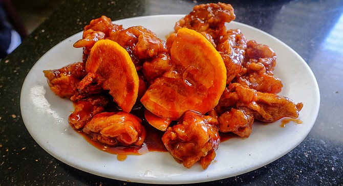 A very orange chicken, orange slices included