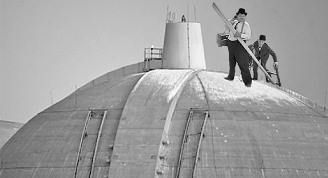 """""""All right, Ollie, let's get this place ready for inspection, on the double!"""" In a recent file photo, San Onofre nuclear waste technicians Stan Laurel and Oliver Hardy prepare to begin their work atop one of the domes at the San Onofre nuclear waste facility. Upon being informed via megaphone that the domes were in no way involved with nuclear waste storage, Laurel turned to upbraid Hardy for making him climb the 200-foot ladder for nothing, but in the process, swung the pole he was carrying and knocked Hardy off-balance. Hardy then grabbed Laurel in an attempt to keep from falling, and the two wound up sliding down the face of the dome and crashing into a tenuously mounted spent-fuel canister below. Fortunately, when the canister rolled off its supports, it rolled onto the two inspectors, who cushioned its fall and prevented it from breaking. The inspectors sustained minor injuries, and are expected to resume their efforts post-haste. """"As you can see, we take safety very seriously here at San Onofre,"""" said facility director Ray D'Ashun. """"Just because we bought faulty equipment that led the the plant's shutdown, and just because our parent company started the Thomas Fire through its own negligence, that's no reason to suppose that the the commission will find anything amiss."""""""