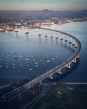 """Jump…to a new morning show"" was imposed over Cuevas' aerial photo of the Coronado Bridge."