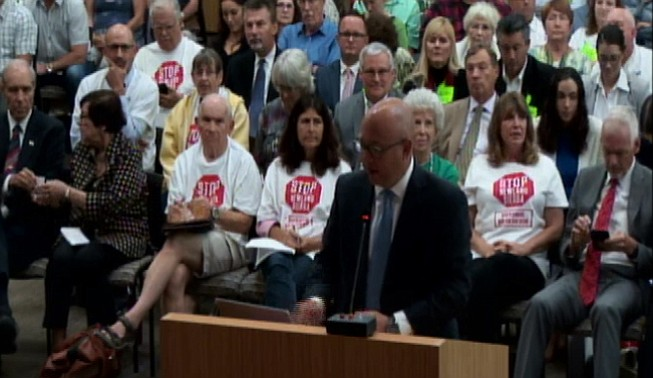 A team of well-connected ladies and lads have been lobbying the county hard for Newland. From June's meeting, Phil Rath at podium and city planning commissioner Jim Whalen in red tie in back.