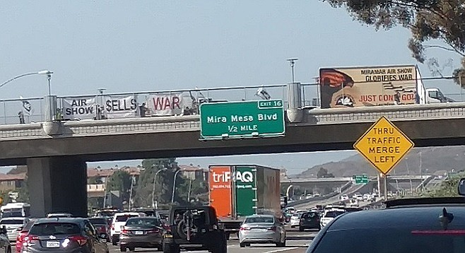 The billboard began slowly crossing the bridge, executing a U-turn, and repeating the process.