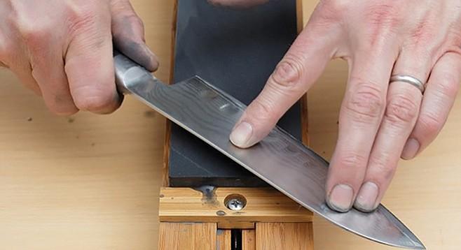 Sharpening Japanese knife on stone