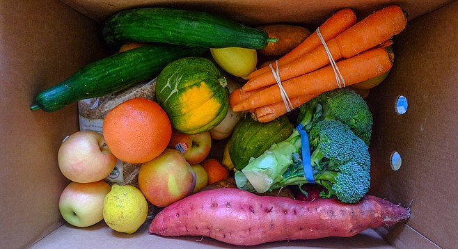 A speckled lemon, flat sided orange, scarred squash, and slightly misshapen carrot are part of a box home-delivered by Imperfect Produce.
