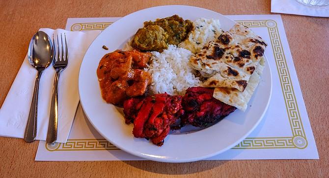 Clockwise from bottom: Chicken tandoori, chicken tikka masala, chicken biryani, upma, naan, rice in center