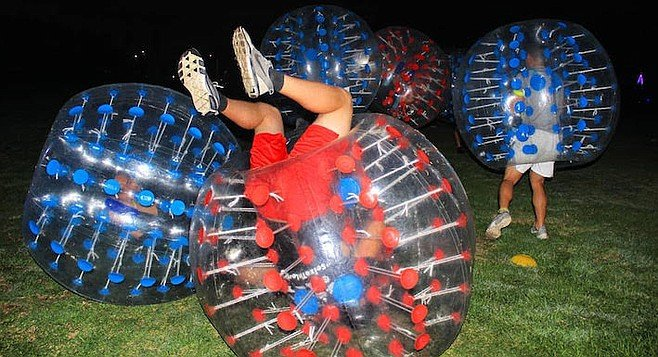 Players are wearing zorb balls, five feet in diameter.