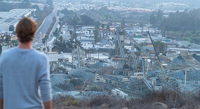 Neighbor looks down on Superior Ready Mix from hillside. Mission Gorge Road on left. - Image by Matthew Suárez