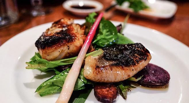 Miso-glazed black cod, served on a bed of vegetables