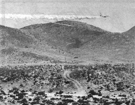 A couple of jets fly over and begin radar bombing beyond the next set of hills.
