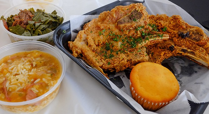 Fried pork chops with rice and gravy, collard greens, corn muffin, and poundcake