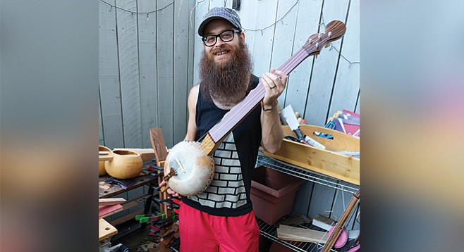 Chris Prieto can't make his gourd banjos fast enough to meet demand