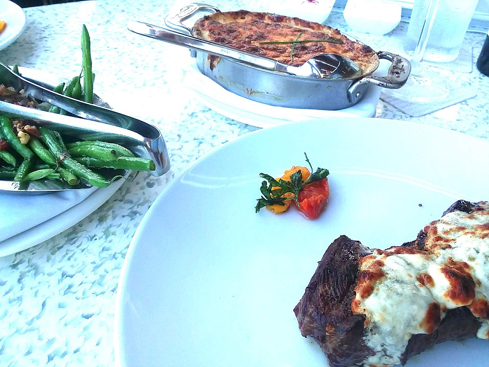 Eye of Ribeye ($56) with green beans ($12) and potato gratin ($12).