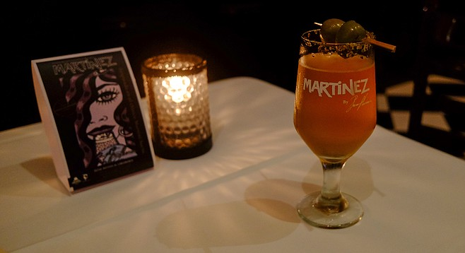 A glass of the dirty martini with olives inspired Martinez, at Restaurante Caesar's.