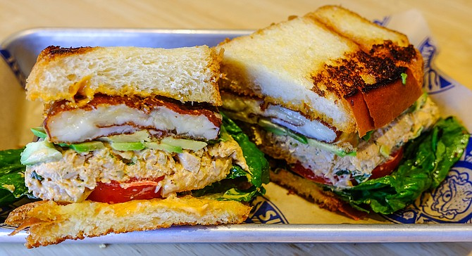 Spicy smoked tuna sandwich with griddled cheese