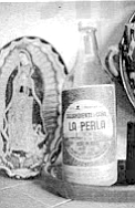Aguardiente, the clear, strong cane liquor made at La Perla, a small factory just down the street from Teresa's house