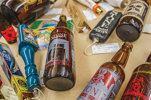 Old tap handles and empty beer bottles are preserved in a collection at the Cal State San Marcos library.
