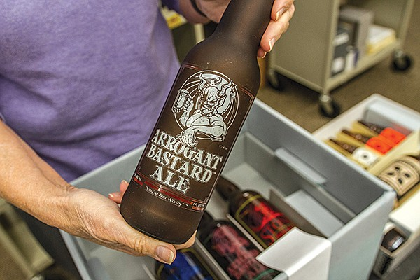 An old Arrogant Bastard Ale bottle, in the collection at the Cal State San Marcos Brewchives