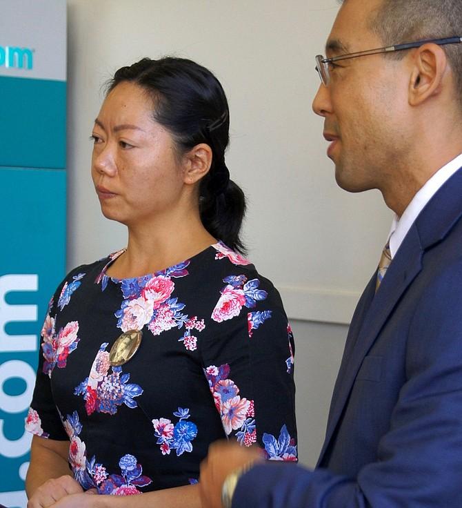 Widow Zui Pang, 41, with prosecutor Watanabe