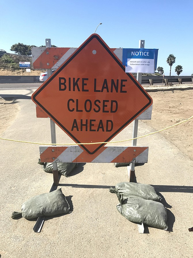 Cyclists that bike along the southside embankment of the San Diego River have stopped because of the sign.