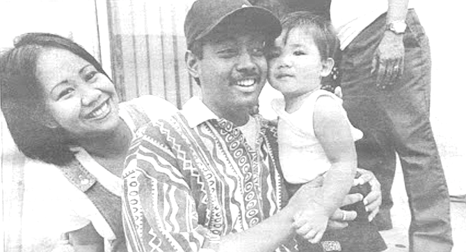 Abigail and Patrick Geske with nephew Oneloe. Abigail, also Filipino, tells me she had to trick Patrick into going to the doctor's. - Image by Sandy Huffaker, Jr.