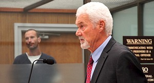 Neil and family attorney Greg Day in court. Photo by Eva Knott.
