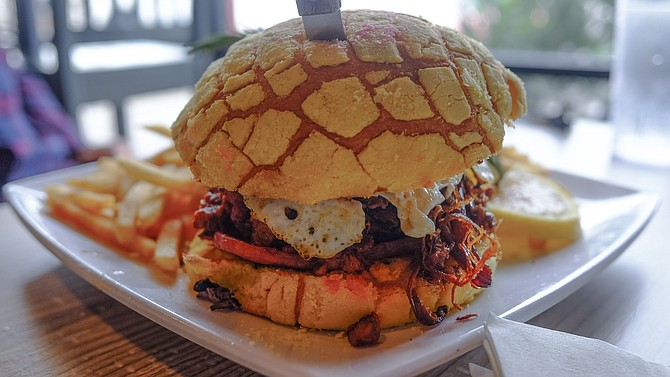 The Mexipino breakfast sandwich is made on a concha sweet roll.