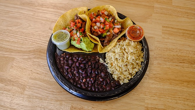 Larger tortillas made with both masa and wheat flour can hold a fair amount of carne asada.