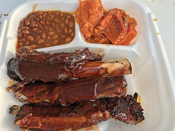 What $6.50 buys: three ribs, two sides. Here: baked beans and candied yams