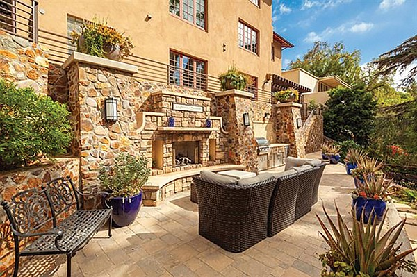 The patio and outdoor fireplace on the upper terrace.
