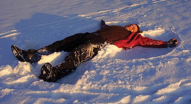 Drunken Adult Making Snow Angel